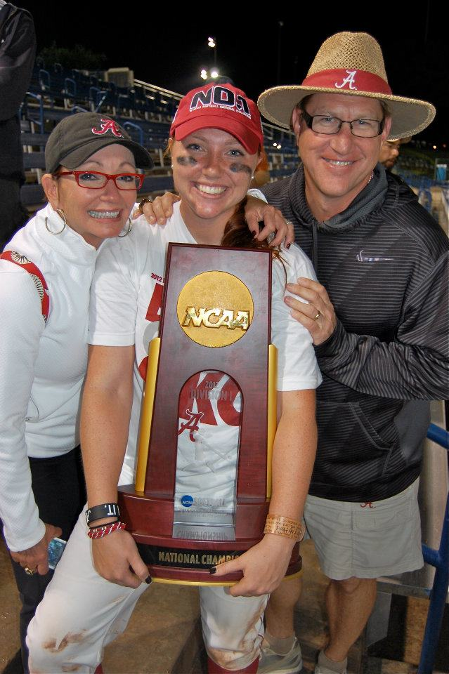 Jordan Patterson (center), holding the national championship trophy, surrounded by her parents.