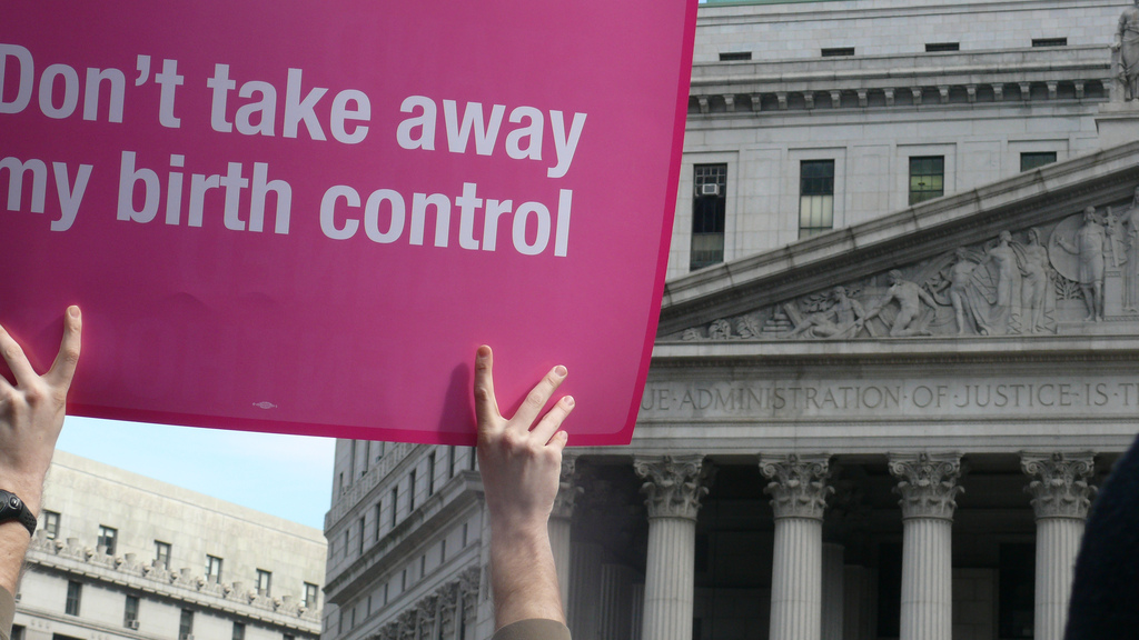 A man holds up a pro Planned Parenthood sign at a rally in New York City in 2011. Photo Credit: Women's eNews/ Flickr (CC By 2.0)