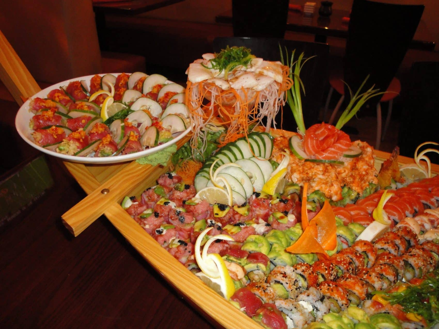 Sushi and sashimi boat with appetizers from Rise Sushi