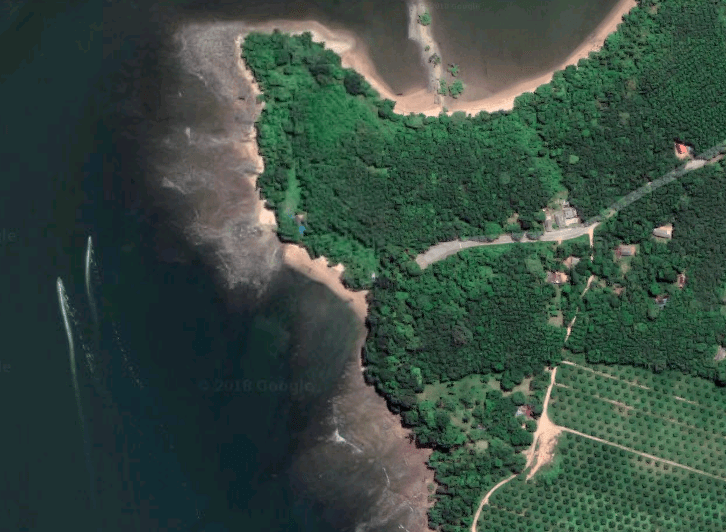 The beach in the center on the left coast — Notice the short forest trek to the beach after the road ends
