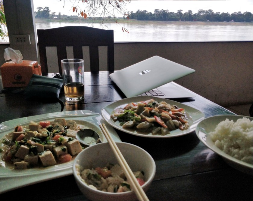 Enjoying the meal and the river in Paksan.