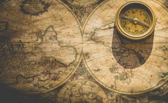 beige analog compass