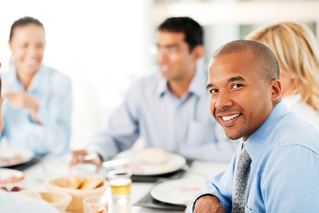 Four businesspeople having lunch in a restaurant.