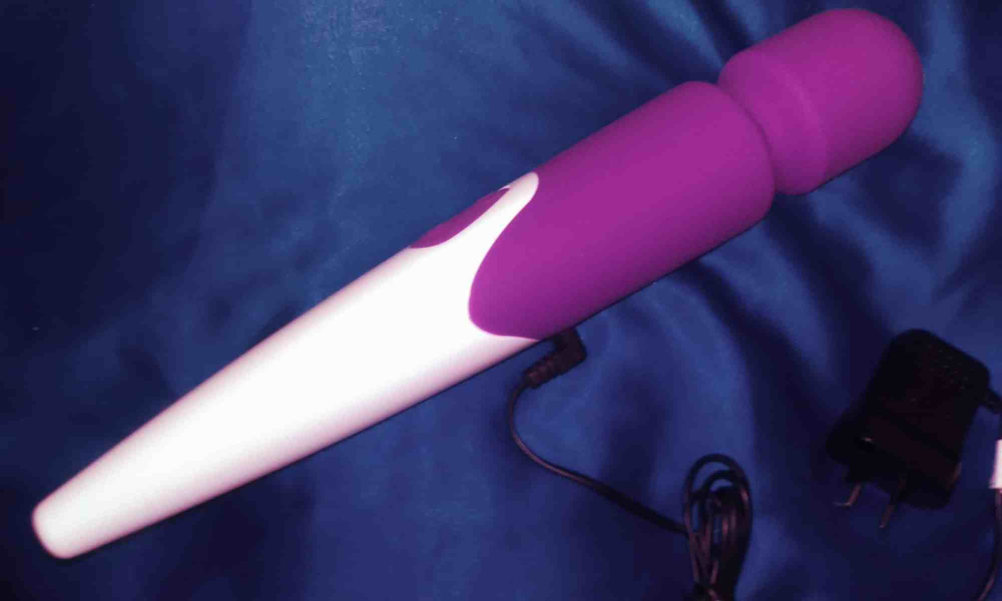 Purple iWand Massager with power cord.