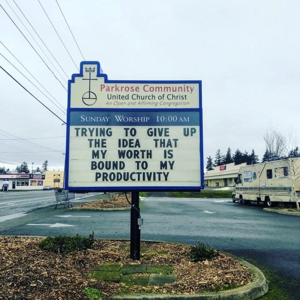 "Church sign with words ""trying to give up the idea that my worth is bound to my productivity"""