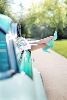 woman-s-legs-high-heels-vintage-car-turquoise-90767.jpeg