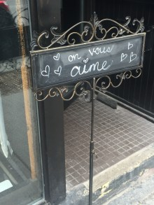 """A sweet message from the restaurant team to the clients, """"On vous aime"""" or """"We love you""""."""