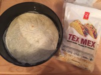 Time to fill the springform pan with the first tortilla