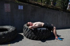"Sam Stewart, 1st year Applied Systems Networking Administration major at RIT, takes a nap while waiting to compete in the 6th Annual Strongman Competition during Imagine RIT 2013 at Rochester Institute of Technology in Henrietta, N.Y. on Saturday, May 4, 2013. ""It's a lot harder than I thought it would be"" said Stewart after 6 hours of competition. (Josh Barber)"