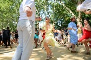 Husband and wife, Anthony Holds and Savannah Wise dance on the main stage to live music at the Jazz Age Lawn Party on Aug. 15, 2015 on Governor's Island. Savannah, a broadway dancer, danced with such confidence and poise as her husband tried to keep up with her.