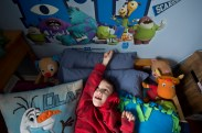 Seven year old, Chase Fekete points up at the monsters on his wall while laying in bed on Feb. 15, 2016. Almost every time he's in bed, whether it's before he goes to sleep or just while reading in the afternoon he points to the monsters because he wants you to say goodnight to them. Chase has Mowat Wilson Syndrome and has been non-verbal all of his life so he communicates by pointing to objects and people.