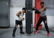 """Giovanni and Cory share a punching bag during practice. Though the boys compete in different age and weight classes, they always practice together. """"They're more like brothers than cousins,"""" said Giovanni's father, Christopher Perkins."""