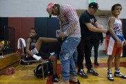 Christopher helps Cory tie his shoes, while Coach TJ tucks in Manny Gonzalez' shirt before the boys warm up for their matches at the Silver Gloves. Brooks lost his match while Gonzalez won.