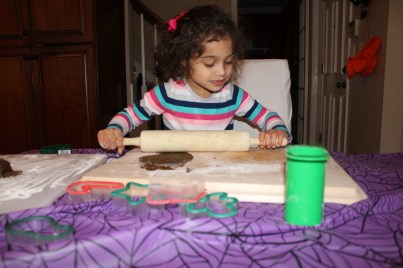 Child rolling out gingerbread