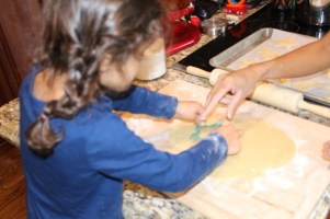 Helping Bea cut out cookies