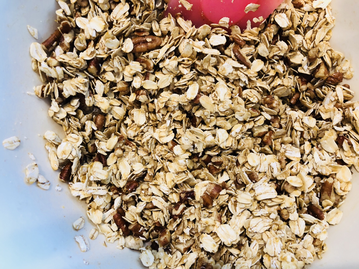 Mix oats and nuts with oil and syrup mixture
