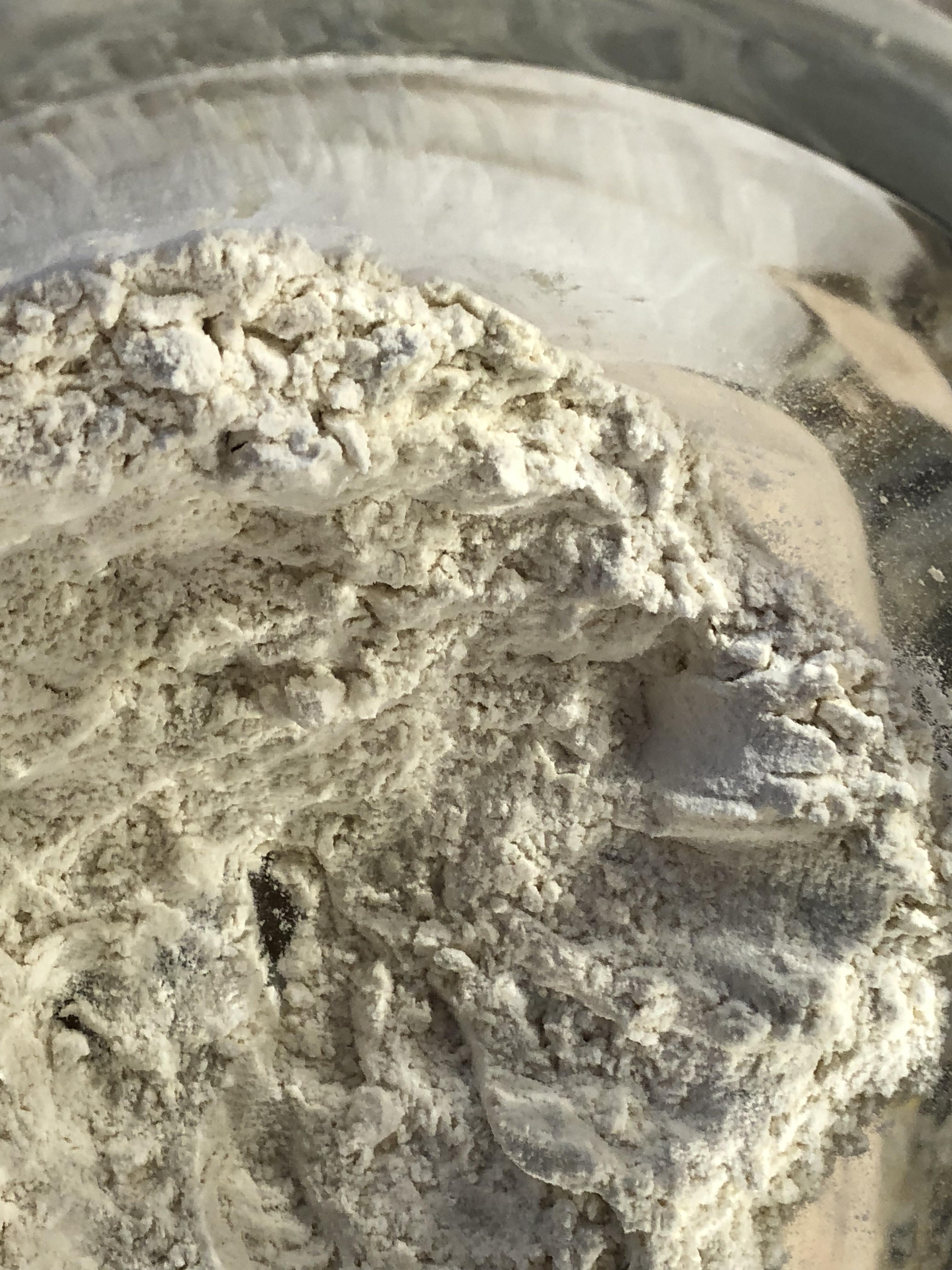 make a well in flour mixture