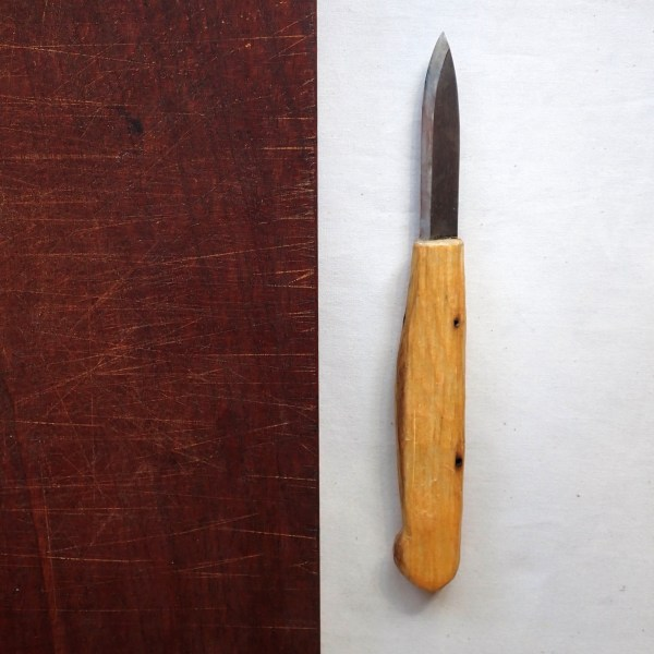 Seven-inch paring knife with hand-forged blade and hand-carved birch handle at RivenJoiner.com.
