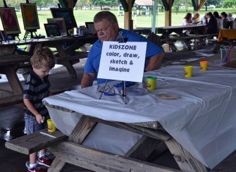 A kids' art activity table was provided by Judith Lynn Smith