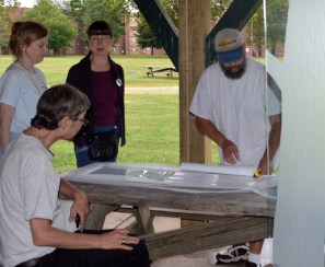 Todd Stokes demonstrates the etched glass process for Mike Bender, Jan Skipo and Judith Lynn Smith