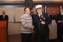 Firefighter Dennis Kenter was honored for length of service (30 years) and lifesaving. Pictured with Capt. Baycan Fideli.