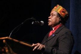 Reverend Mary Cooper, pastor of the House of Praise in Riverhead, delivers an invocation. <em>Photo: Katie Blasl</em>