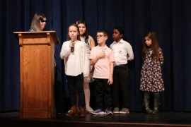 "Roanoke Avenue Elementary School third-graders introduce the chorus for its performance of ""If I Had a Hammer."""