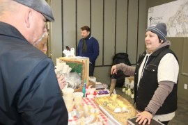 Christine Rudkowski of Mecox Bay Dairy offers cheese tastings to customers.