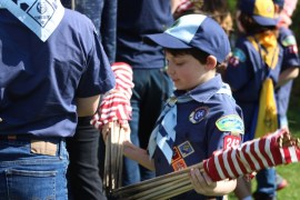Bundles of flags were distributed to Scouts
