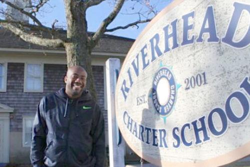 Riverhead Charter School principal Raymond Ankrum Sr. outside the school last spring.