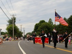 Jamesport Fire Department members lead the department's annual parade last night on Main Road. (Photo: Emil Breitenbach Jr.)