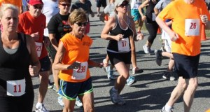 Eileen Benthal, far left, running in the Jamesport FD 5K last Sunday. (Photo: Denise Civiletti)