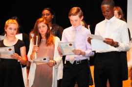 New inductees into the Spanish Honor Society take their oath. Courtesy photo