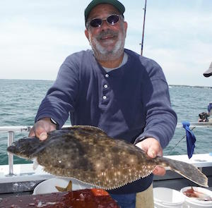 A fluke caught and release last Saturday. Fluke season opened Tuesday. Photo: Ken Holmes