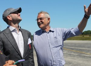 Luminati cofounders Daniel Preston, left, and Stefan Maier admiring their prototype aircraft as it flew before a crowd today at the former Grumman site in Calverton. Photo: Denise Civiletti