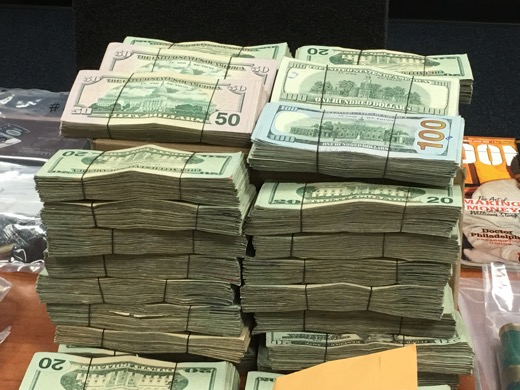 Some of the cash seized by law enforcement officers during the recent raids. Photo: Denise Civiletti