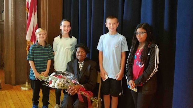 four pulaski street school sixth graders d winners of annual  from left are essay