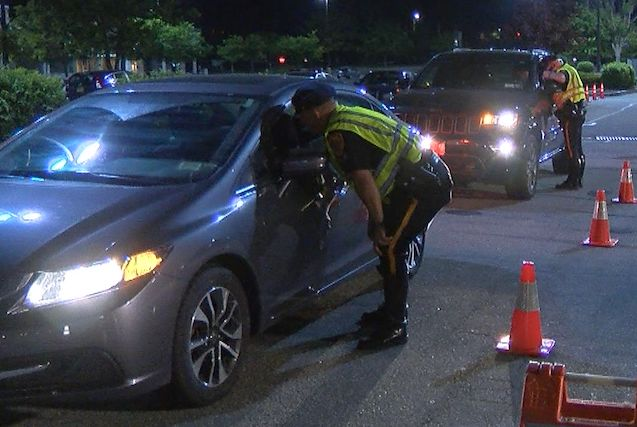 Police check cars at a sobriety checkpoint in 2018. File