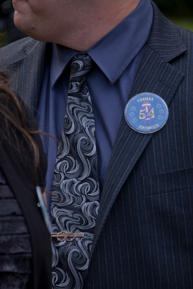 Buttons honoring Tom Cutinella at his funeral Tuesday. (Credit: Paul Squire)