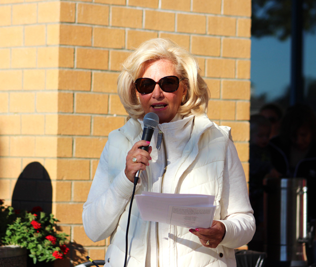 Janine Nebons, general manager of Tanger Outlets, thanks sponsors and instructs crowd about the walk.