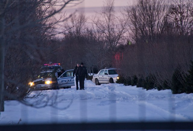 Riverhead police investigate at an Aquebogue nursery Friday evening. (Credit: Paul Squire)