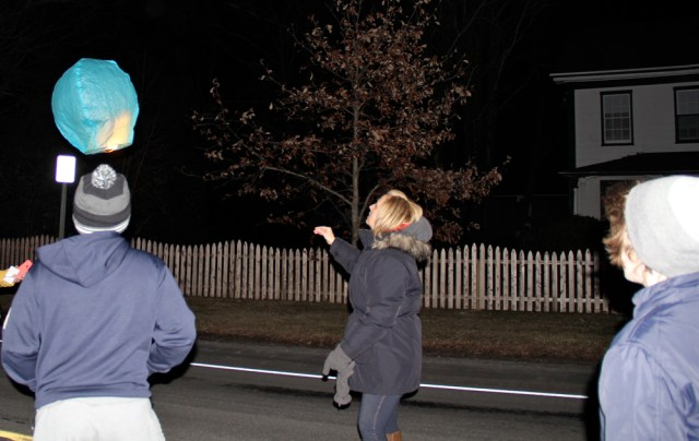 Windy conditions did not get in the way of Ms. Callaghan's plan to light lanterns in his honor.