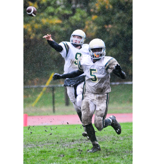 McGann-Mercy quarterback KJ Santacroce lets go a pass as running back Reggie Archer blocks in front. (Credit: Bill Landon)