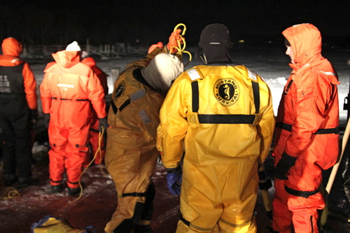 Firefighters venturing off onto the ice wore Mustang suits to protect them from the icy waters.