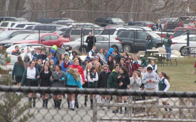 Students are evacuated from McGann-Mercy High School Wednesday afternoon. (Credit: Tim Gannon)