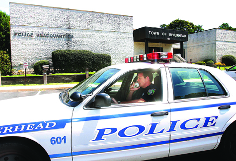 BARBARAELLEN KOCH FILE PHOTO | Riverhead police officer Tim Murphy outside the town's police headquarters on Howell Avenue.