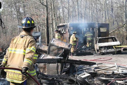 PAUL SQUIRE PHOTO  |  Volunteer firemen fighting the wildfires in Manorville last year.