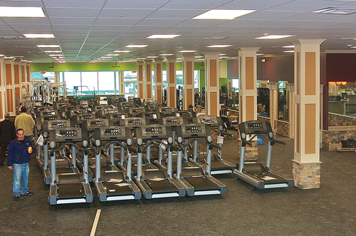 Maximus Health & Fitness is expected to open within the next couple of weeks in the former Woolworth building on East Main Street. Pictured is the 25,000-square-foot main exercise room. (Credit: Barbaraellen Koch)