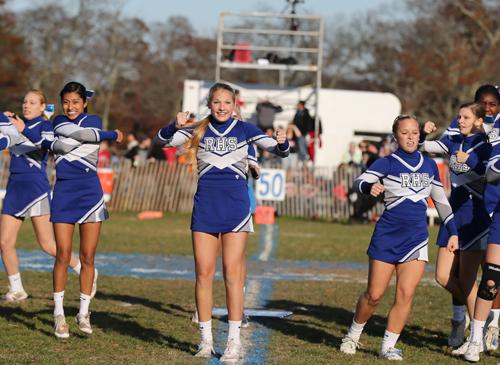 Riverhead cheerleaders perform during halftime of a football game Nov. 16. (Credit: Daniel De Mato)