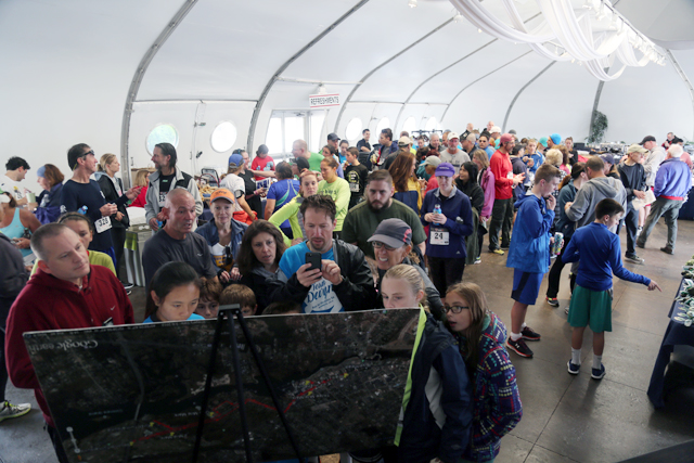 Runners check their times and enjoy refreshments after the 5K Saturday morning. (Credit: Krysten Massa)